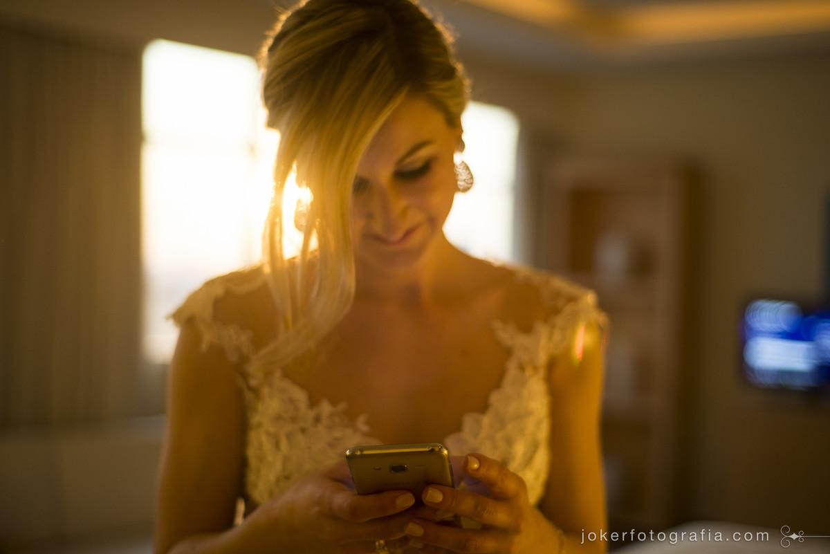celular no dia do casamento e por do sol
