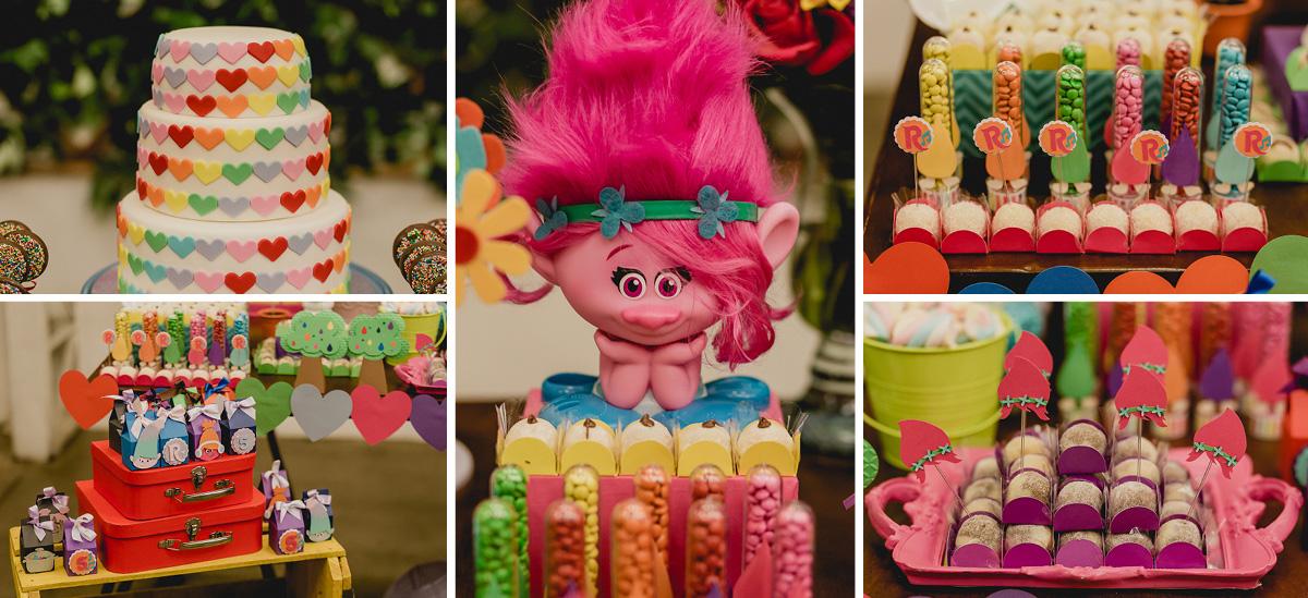 detalhes da mesa do bolo com o tema trolls