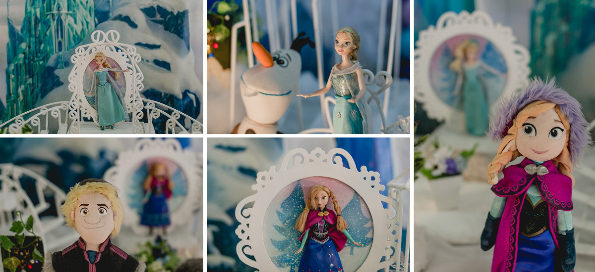 detalhes da mesa do bolo com o tema frozen