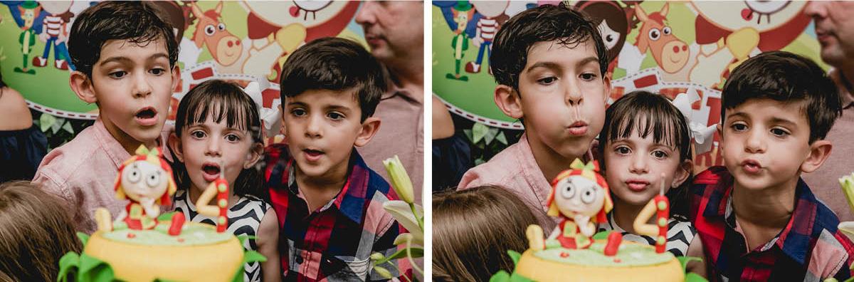 Bia, irmão e primo apagando a vela do bolo juntos