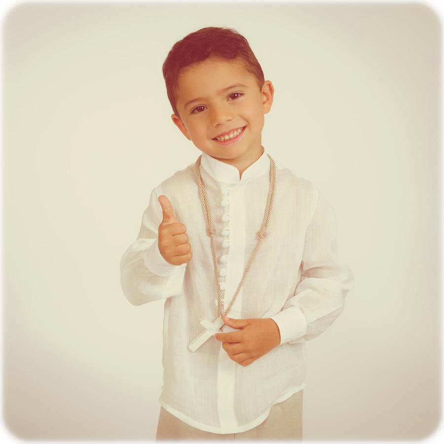 fotografia de estúdio miúdo batizado