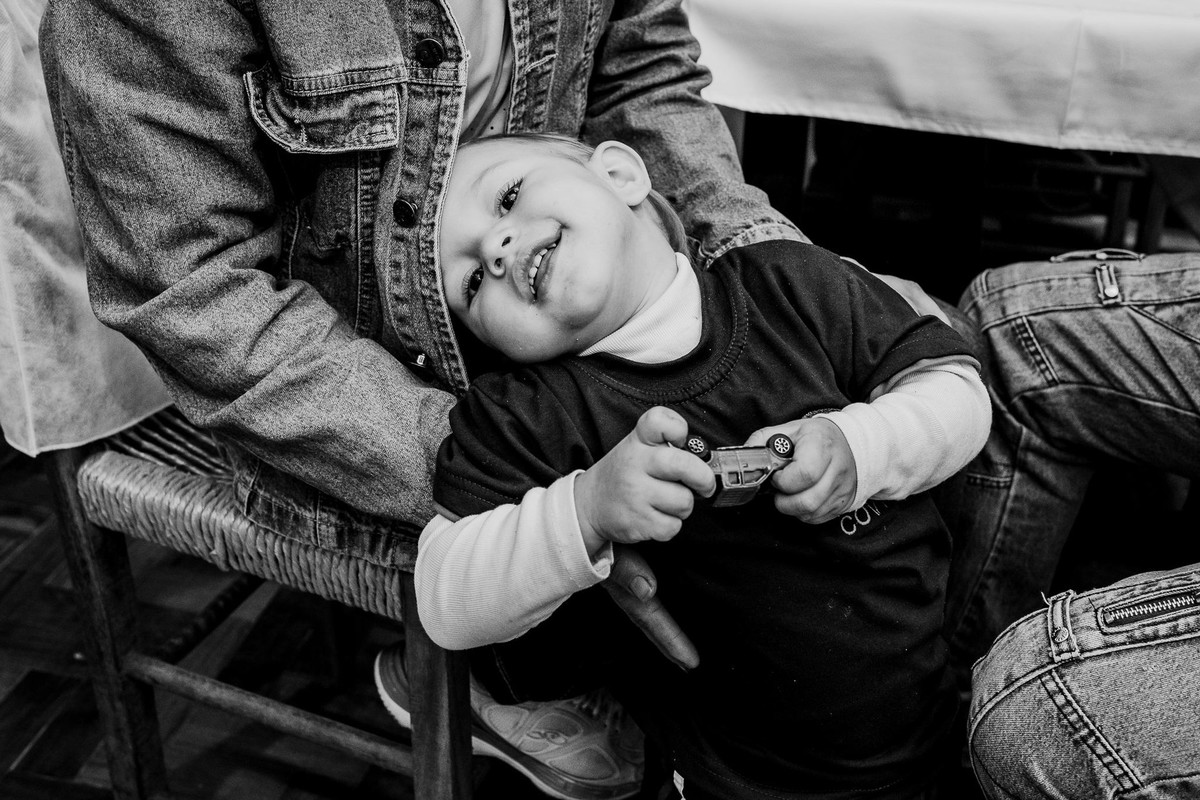 bw picture of a sweet child on his mom lap