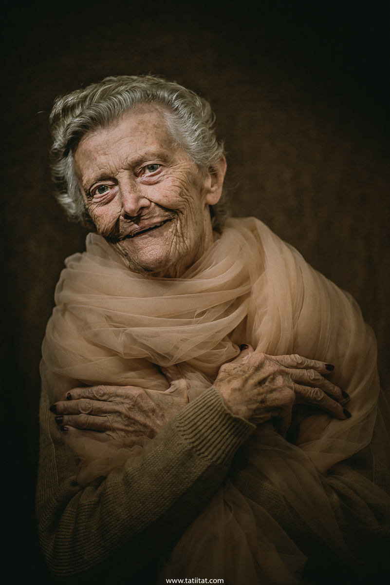 elderly woman expresses through tenderness and kindness look