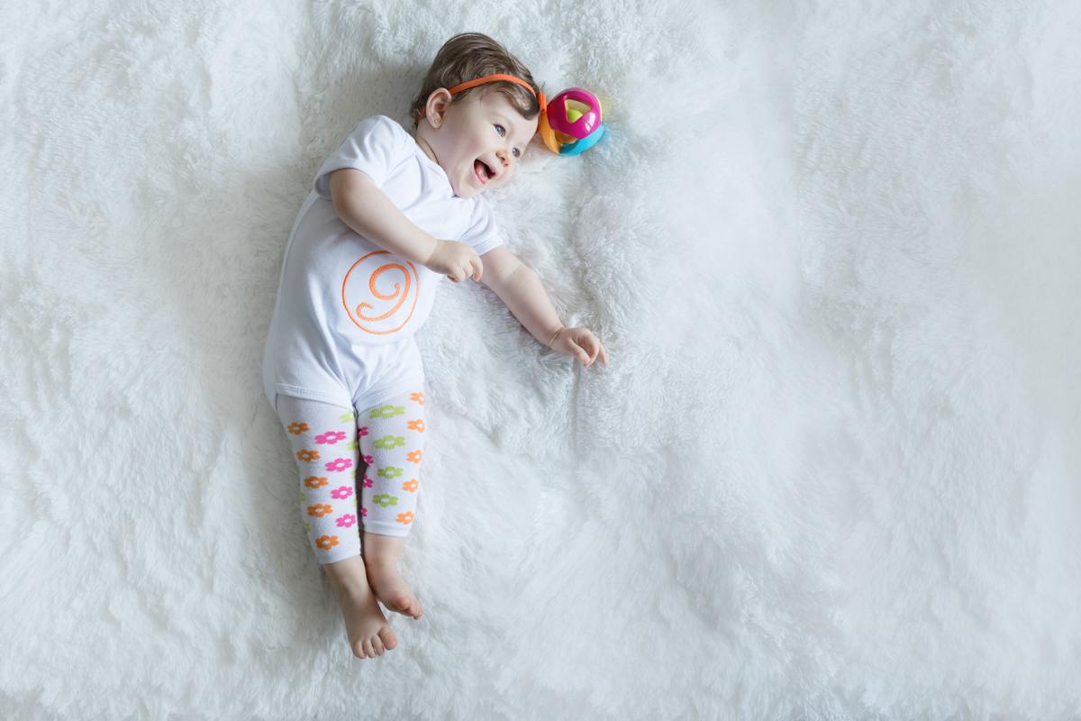 Bebê se diverte na sua sessão de fotos