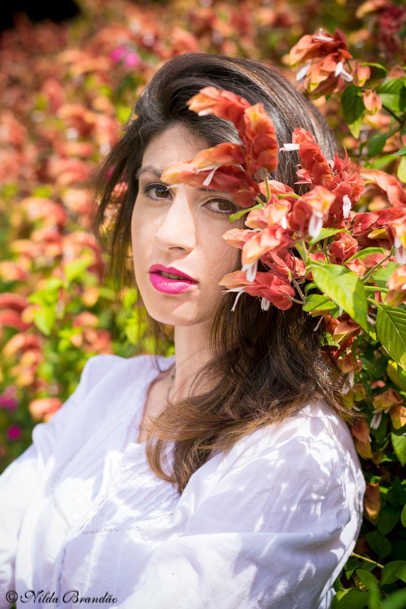 Usando o muro de flores para criar um fundo para fotografias