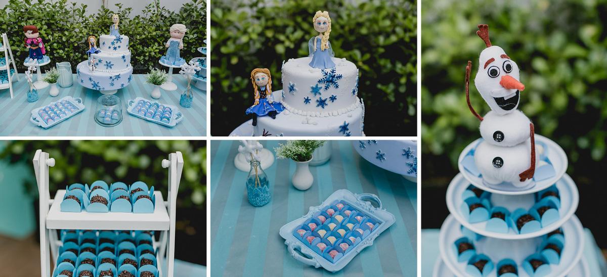detalhes da mesa do bolo com o tema da frozen