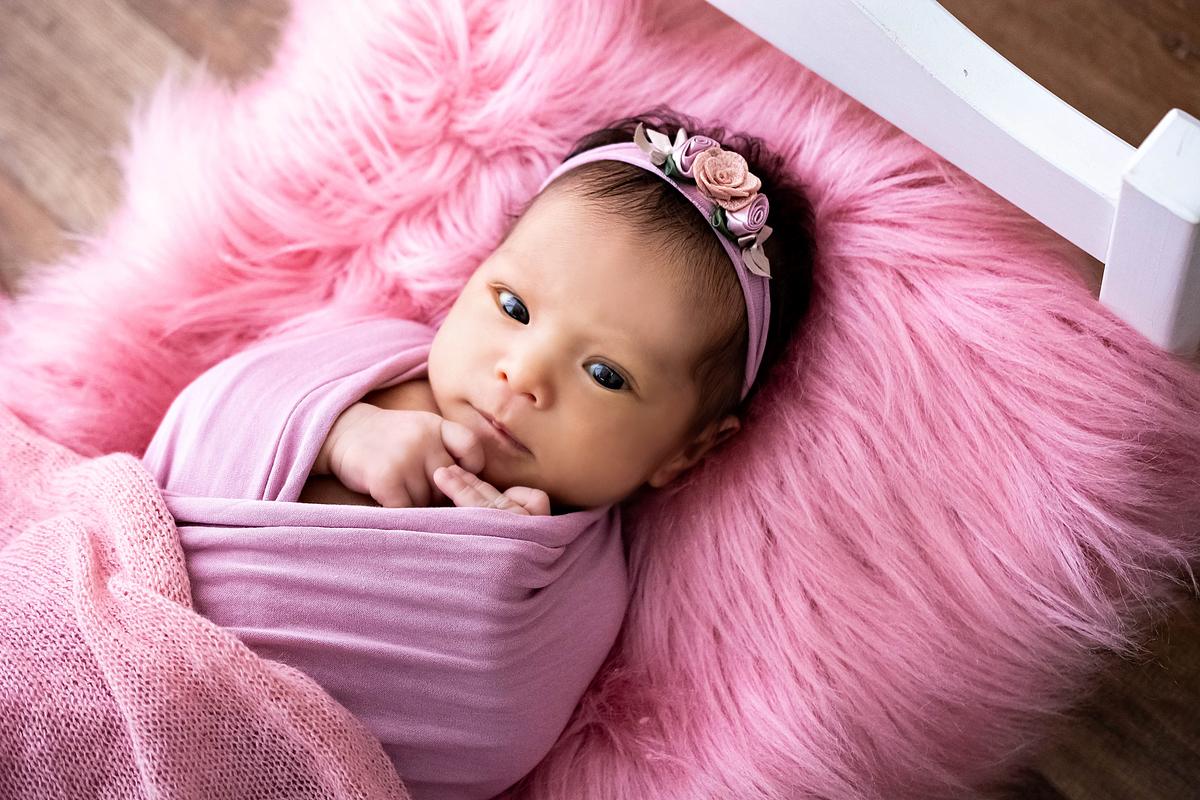 Imagem capa - 6 Motivos Para Fazer O Newborn Do Seu Filho por Mel Ribeiro
