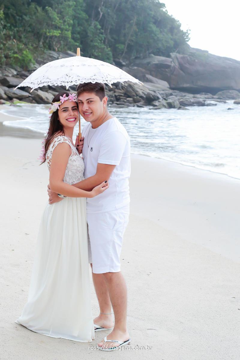 fotografia de casal na praia