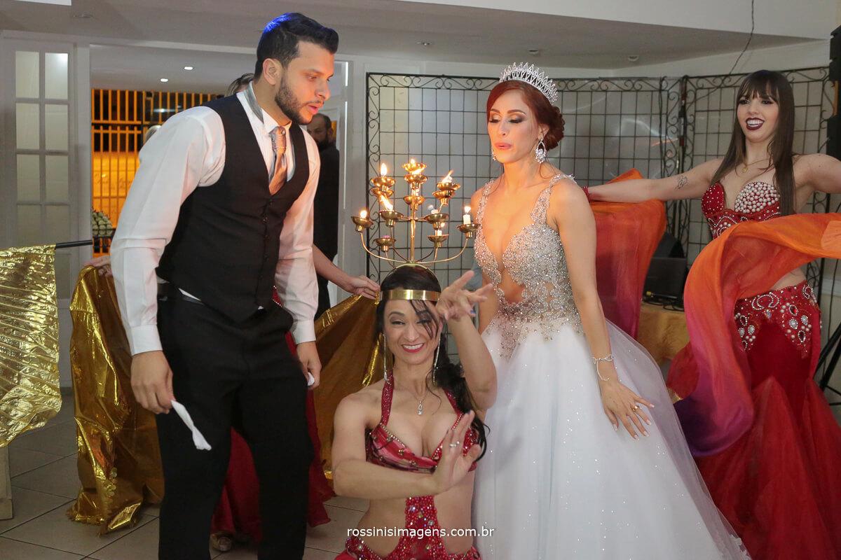 noivos dançarinos, apagando o candelabro, apagando o castiçal, apagando as velas, cortejo árabe