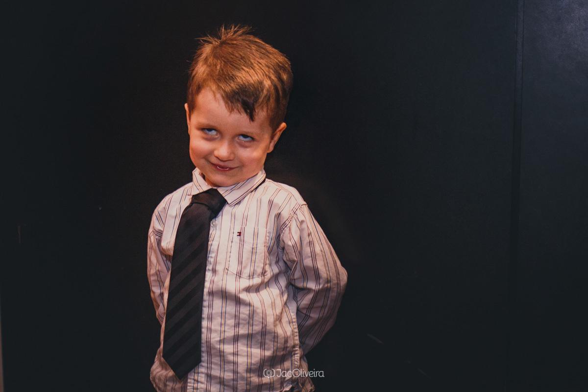 fotógrafo formatura festa porto alegre; sobrinho da formanda menino faz careta
