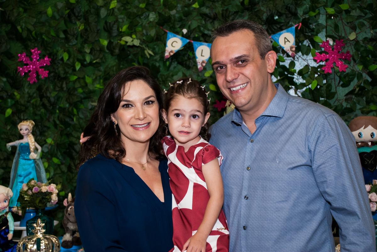 fotografia de Clara com os pais
