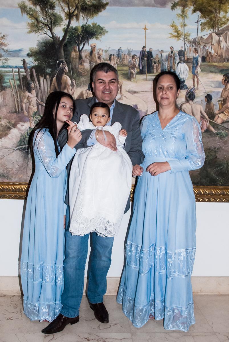 A família chegando para o batizado