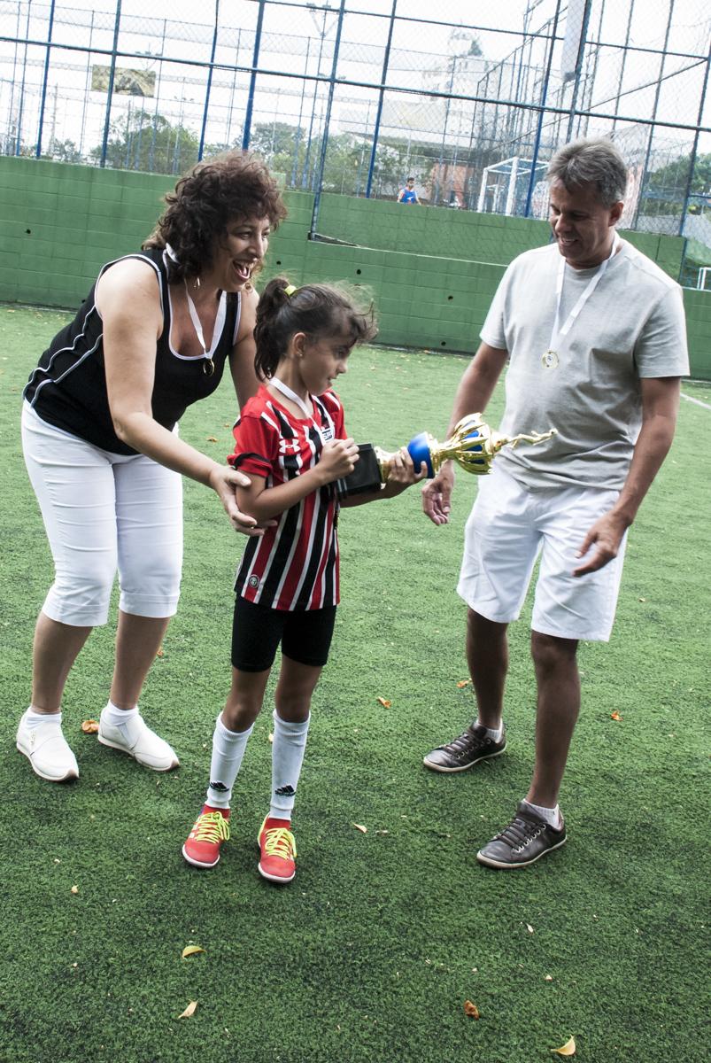 compartilhando o premio com os pais