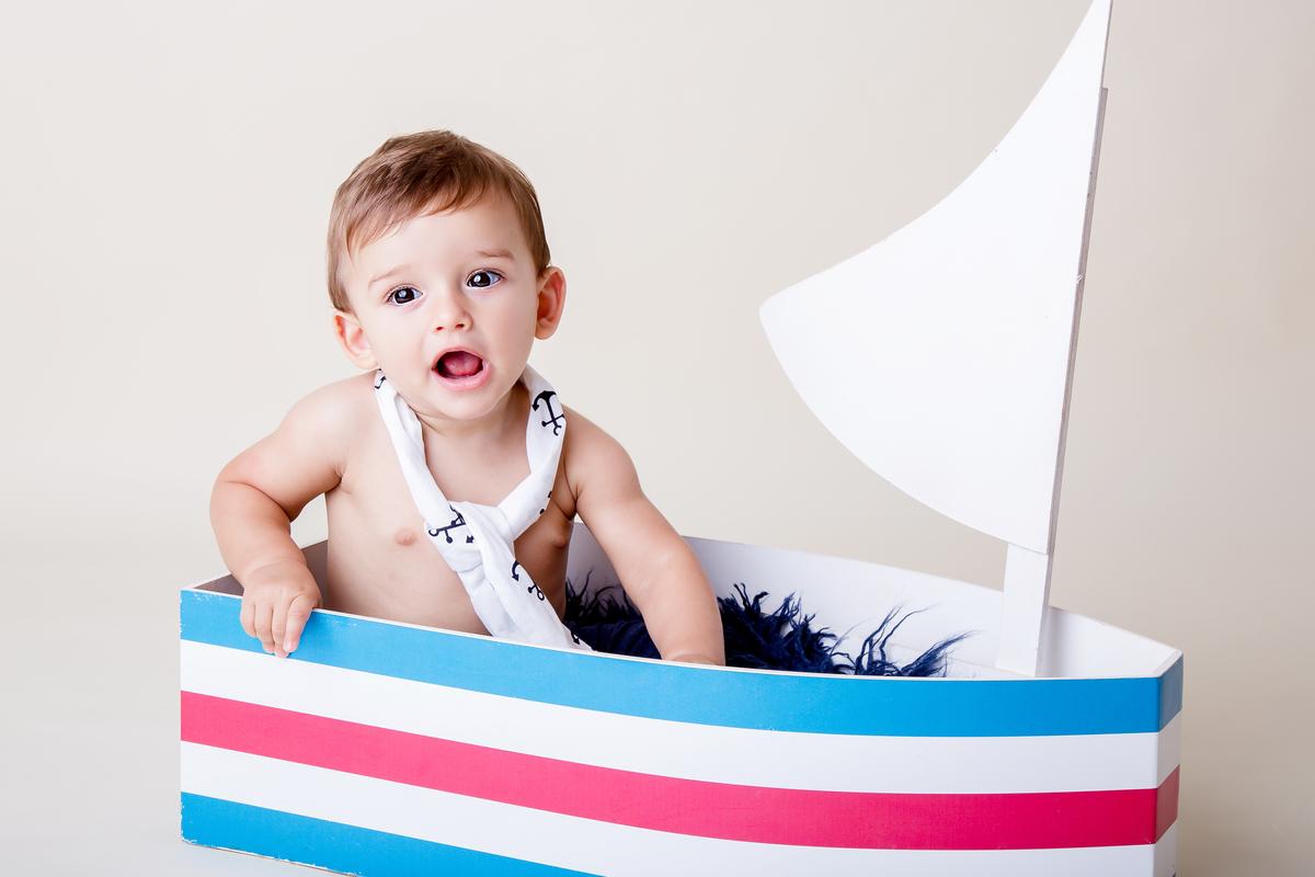 bebê de nove meses barquinho, bebe sorrindo, ensaio de acompanhamento Brasilia