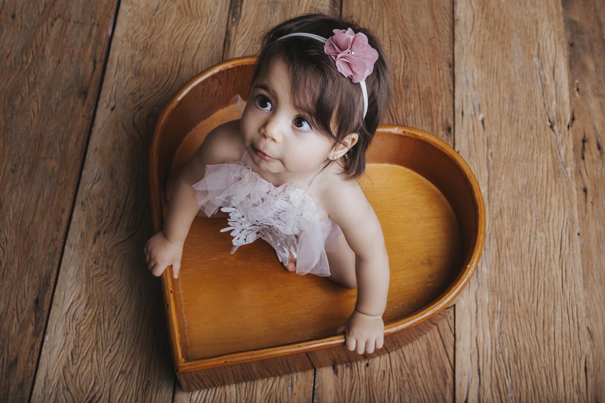 meu coração fora do peito em ensaio de acompanhamento do primeiro ano de vida do bebê, Brasilia DF, Gabi Aine