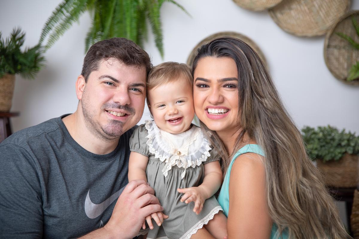 amor de familia em ensaio do primeiro ano do bebê