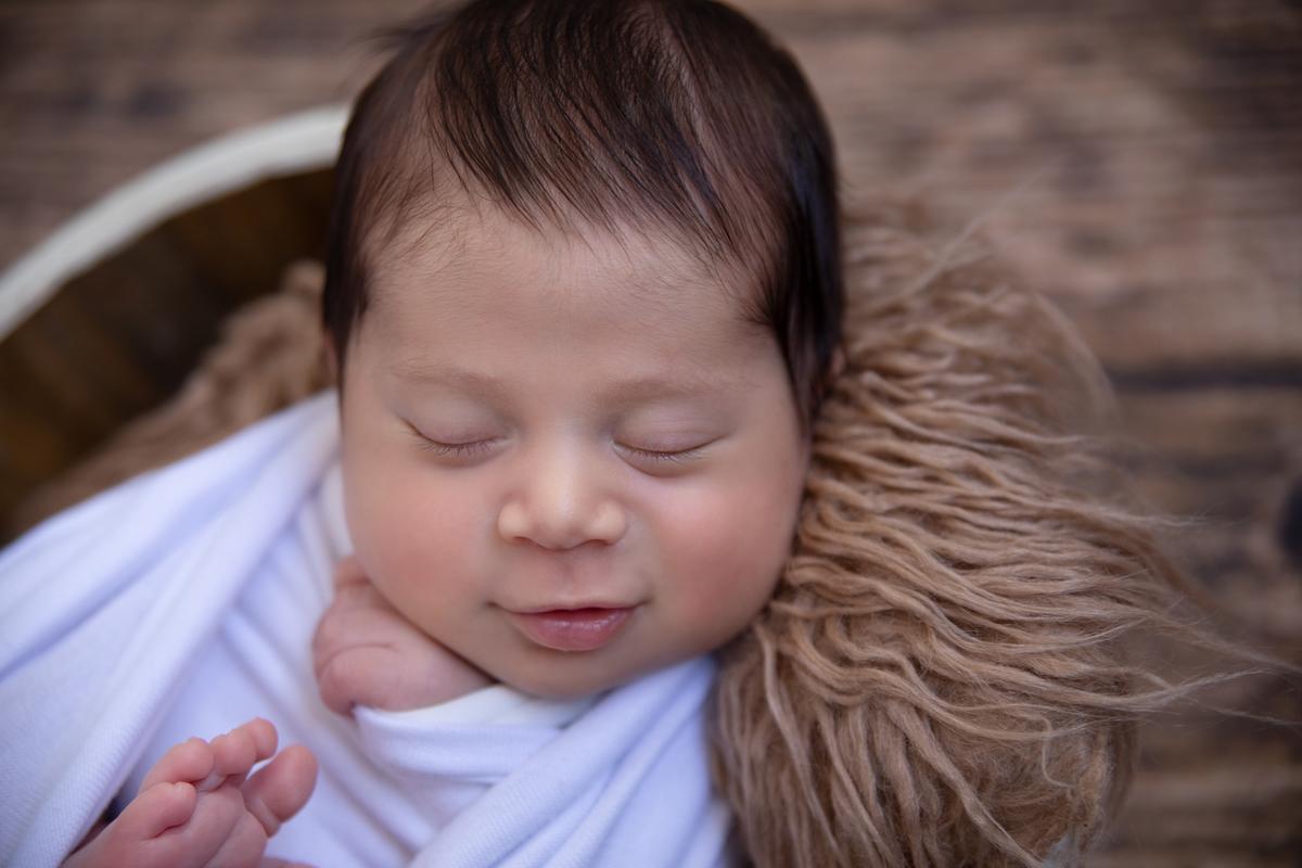 Sorriso no ensaio newborn Brasília